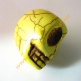 Calavera mexicana howlita 17 mm color amarillo.
