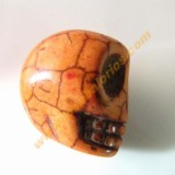 Calavera mexicana howlita 17 mm color naranja.